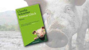 """Buchcover von """"Emmas Glück"""" im Vordergrund, Schweineschnauze rechts neben dem Cover"""