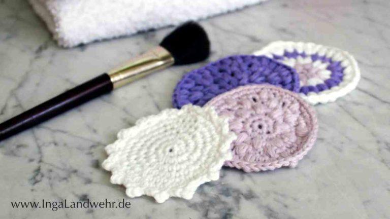 3 verschiedene Kosmetikpads in weiß, rosa und lila